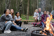 Families Sitting By The Campfire