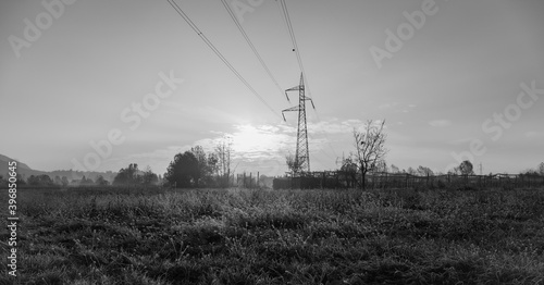 Tela High voltage pylon in the countryside. Black and white photos