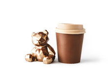 Beautiful Chocolate Bear With Chocolate Takeaway Cup Of Coffee On Isolated White Background. Abstract Design Template On White Backdrop. Food And Drink Concept. Coffee Background. Copy Space.