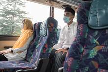 Muslim Couple Wearing Masks An...