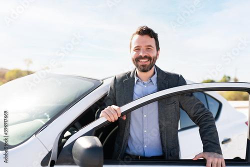 Latin man making eye contact while smiling and getting off a vehicle Billede på lærred