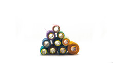 Front View Pyramid Of Various Colors Of Sewing Thread Roll On An Isolated White Background.