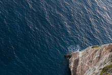 High Cliff And Sea Water, Top View. Rocky Coast