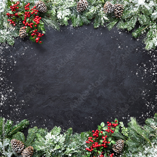 canvas print motiv - Alexander Raths : Christmas and New Year background with fir branches and snowfall on dark stony board
