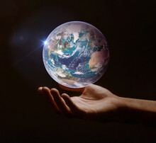 Earth, Our Planet Is In Our Hands, Protection And Global Care Concept. Retouched Image. Elements Of This Image Furnished By NASA