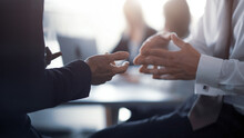 Close Up. Meeting Of Project Leaders. Hands Of A Business People Having A Project Discussion Or Business Agreement Together. Team Work Process. Blurred Background. 16x9 Size