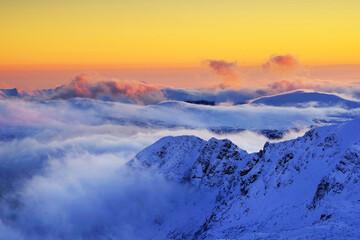 Winter alpine landscape in National Park Retezat, Carpathians, Romania, Europe. Snow covered moutains scenery