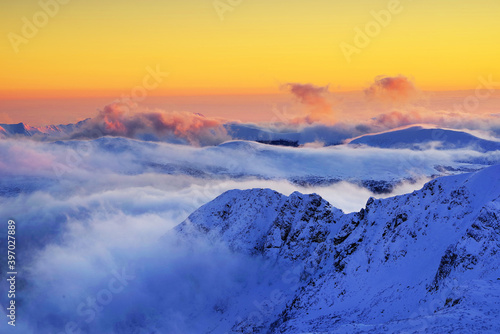 Winter alpine landscape in National Park Retezat, Carpathians, Romania, Europe. Snow covered moutains scenery