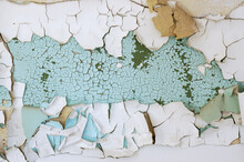 Cracked Wall With Flaking Turquoise Paint