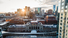 """Denver, CO USA - 11-29-2020: Aerial Shot Through The Buildings Of The Downtown Denver Skyline With The Union Station In The Foreground."""