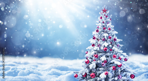 Snowy Christmas Tree With Red Balls In A Winter Landscape