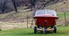 Boat On Trailer In Farm Yard
