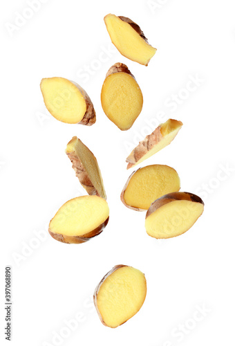 Fotografie, Tablou Fresh sliced ginger falling on white background