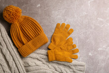 Stylish Gloves, Scarf And Hat On Light Grey Marble Table, Flat Lay
