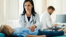 Female Doctor In White Coat Pa...