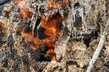 Burning Natural Gas In Old Oil Wells.The Deposits Of  Mineral Wax.Mud Volcano In The Village Of Starunia Bogorodchany District Ivano-Frankivsk Region,Ukraine.