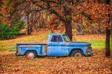 Old, Abandoned Blue Truck Surrounded By Beautiful Fall Foliage In Autumn