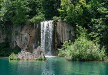 Fototapeta na wymiar Plitvice Lakes in Croatia. Sightseeing place. Very popular among tourists. Beautiful Landscape and Nature. Summer view of beautiful waterfalls in Plitvice Lakes National Park