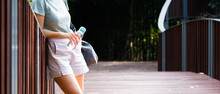 Beautiful Banner Eco Friendly Sustainable Lifestyle Concept. A Young Woman Walking Outdoor With A Personal Carry On Reusable Water Bottle And Cloth Bag Concerning About Zero Waste In Daily Life.