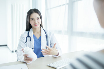 Woman doctor working in the office