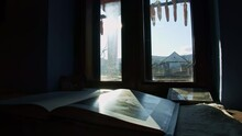 In An Old House, In An Old Village In Romania, The Sun Shines Trhough The Window On A Photobook That Keeps So Meny Memories