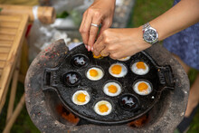 Fried Quail Eggs Pancake On Pothole Pan Thai Appetizer At Street Food Market Thailand.Thai Desserts And Snack Meal.cavity,pit