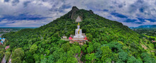 Mueang Lop Buri District, Lopburi / Thailand / October 10, 2020  : Wat Siri Chanthanimit Worawihan And Big White Buddha Statue With Royal Umbrella On A Mountain.