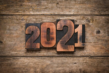 Year 2021 Written With Letterpress Printing Blocks On Rustic Wooden Background