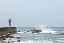 Coastline Of Atlantic Ocean. Rainy Day And Waves. Historical Felgueiras Lighthouse Built On 1886 In Foz Do Douro Near From Porto, Portugal