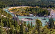 Spectacular From Above View Of Bow River With Hoodoos Or Fairy Chimneys Surrounded By Colorful Autumnal Forest In Banff National Park In Canada