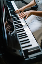 Crop Anonymous Female Musician Playing Piano While Practicing At Home At Weekend