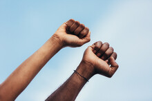 Fists Of Anonymous Persons As A Gesture Against Racism.
