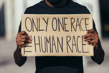 Anonymous Man Protesting At A Rally For Racial Equality Against Racism. Black Lives Matter.