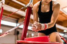 Young Artistic Gymnast Woman Preparing Hands With Magnesia For Uneven Bars