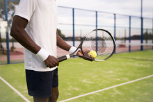 Black Man Holding Tennis Racket And Ball On Field Playing Newtennis