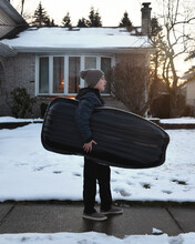 Child Walking Outside With Winter Sled