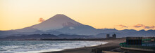 Beautiful Shoreline And Silhouette Of Mt. Fuji At Sunset Time