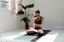 Content Woman In Lotus Pose Em...