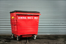 Red Garbage Container On The Street In A Industrial Area