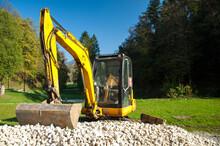 Yellow Mini Excavator On A Construction Site