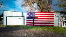 Crucifix And American Flag At Garage