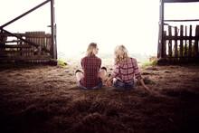 Caucasian Women Sitting On Hay...