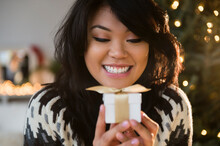 Pacific Islander Woman Holding Small Wrapped Gift
