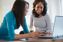 Mother And Daughter Online Whopping With Credit Card And Laptop