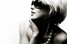 Portrait Of Glamorous Caucasian Teenage Girl Wearing Sunglasses