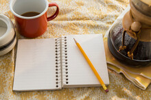 Studio Shot Of Jurnal And Coffee