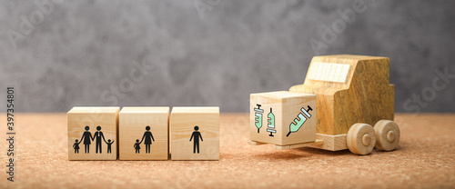 Fotografia forklift with cube with syringe symbols and cubes with person symbols symbolizin