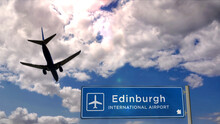 Plane Landing In Edinburgh Scotland Airport With Signboard