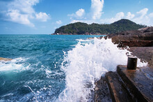 Scenic Views Of The Indian Ocean Washing Over The Rock Formations At Samui Island, Thailand.