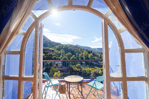 Canvas Print Table and chairs on the balcony terrace with nice view over the Chefchaouen, Morocco